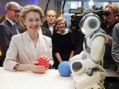 President of the European Commission Ursula von der Leyen looks at an invention at the AI Xperience Centre at the VUB (Vrije Universiteit Brussel) in Brussels (Stephanie Lecocq, Pool Photo via AP)