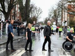 The Duke of Sussex, Jon Bon Jovi and members of the Invictus Games Choir walk on the famous zebra crossing outside the Abbey Road Studios in London (Hannah McKay/PA)