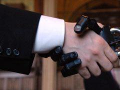 A human hand shaking a robotic hand (Tim Ireland/PA)