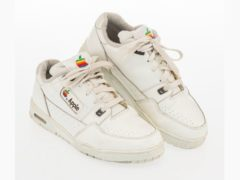 Apple-branded trainers sell for almost £8,000 at auction (Heritage Auctions/PA)