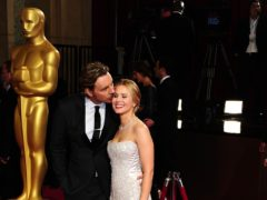 Frozen star Kristen Bell lifted the spirits of isolating husband Dax Shepard by dancing outside the apartment he is quarantined in (Ian West/PA)