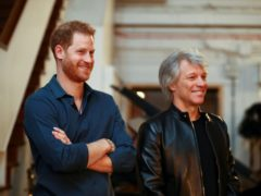The Duke of Sussex meets Jon Bon Jovi (Hannah McKay/PA)