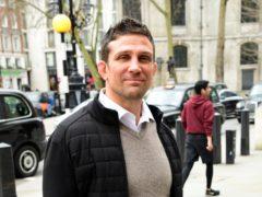 Alex Reid outside the High Court in London (Ian West/PA)