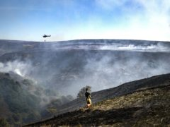 More than 100 firefighters and soldiers tackled the wildfire on Saddleworth Moor in 2018 (Danny Lawson/PA)
