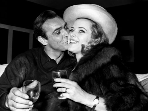 Honor Blackman alongside Sean Connery in 1964 (PA)