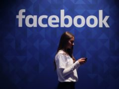 Facebook is to show messages to people who have interacted with misinformation about coronavirus, and guide them towards official advice (Niall Carson/PA)