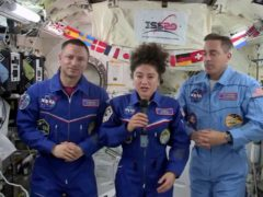 Astronaut Jessica Meir with Andrew Morgan and Chris Cassidy (Nasa via AP)
