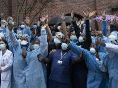 Healthcare workers at Brooklyn's Kings County Hospital Centre (Mark Lennihan/AP)