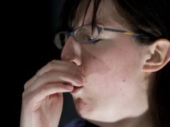 Researchers seeking a way of detecting coronavirus from the sound of a person's cough or even their voice have launched an app to collect recordings from as many people as possible (Posed by model/PA)