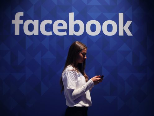 An optional survey will appear at the top of users' News Feeds (Niall Carson/PA)