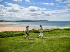 People enjoy a walk in Woolacombe, Devon (Ben Birchall/PA)