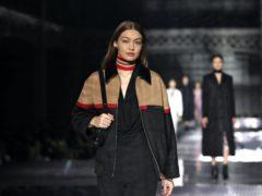 Gigi Hadid has donated a Fenty top and skirt and Dior saddlebag (Aaron Chown/PA)