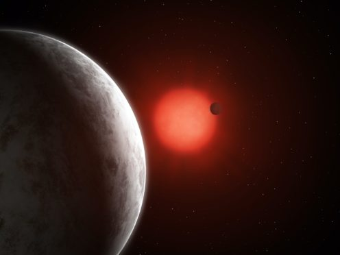 Artist's impression of the multiplanetary system of newly discovered super-Earths orbiting nearby red dwarf Gliese 887 (Mark Garlick)