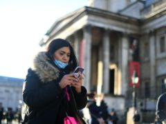 A woman wearing a face mask outside the National Gallery (Victoria Jones/PA)