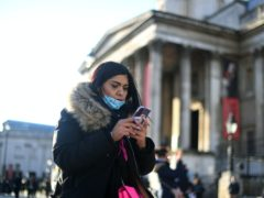 A woman outside the National Gallery (Victoria Jones/PA)
