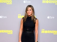 Jennifer Aniston has shared her Emmys preparation – showing off her face mask and champagne (Ian West/PA)