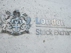 A view of the London Stock Exchange sign in the City of London, as the FTSE 100 Index nudged lower (Kirsty O'Connor/PA)