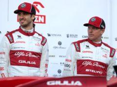 Kimi Raikkonen (right) and Antonio Giovinazzi have signed with Alfa Romeo again for next season (David Davies/PA)