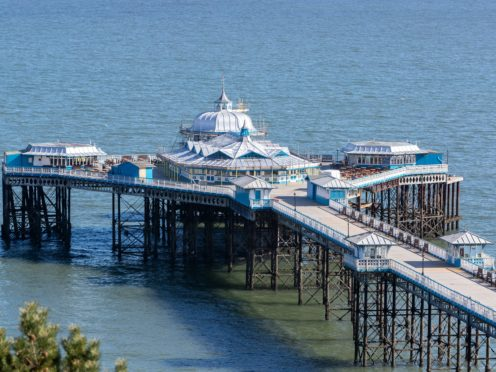The pier at Llandudno, north Wales, stands empty during lockdown (Peter Byrne/PA)