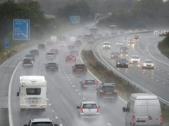 Cars make their way along the M4 motorway near to junction 18, as heavy rain is lashing parts of the UK, with the Met Office issuing warnings not seen since March.