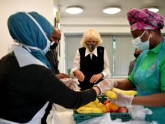 The Duchess of Cornwall packs brownies baked at Clarence House into food parcels at the Pepper Pot Centre (Justin Tallis/PA)