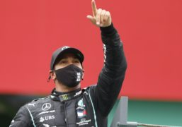 Lord Hain says it is 'unacceptable' that Lewis Hamilton, pictured celebrating the Portuguese Grand Prix victory that gave him a record 92 F1 race wins, has yet to be knighted (Rafael Marchante, Pool via AP).