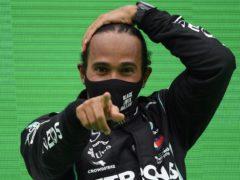 Mercedes driver Lewis Hamilton claimed a Formula One world record of 92 Grand Prix wins on Sunday (Rudy Carezzevoli/Pool via AP)