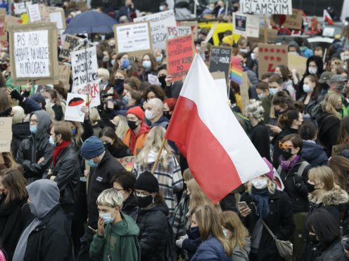 Women's rights activists hold placards during a protest in Warsaw, Poland (Czarek Sokolowski/AP)