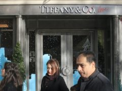 People walk past a Tiffany jeweller's shop on the Champs Elysees (Michel Euler/AP)