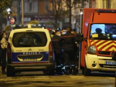 Police officers at the scene after a Greek Orthodox priest was shot in the city of Lyon, central France (Laurent Cipriani/AP)