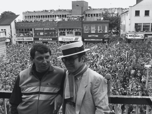 Watford chairman Elton John, wearing the club scarf, with team manager Graham Taylor (PA)