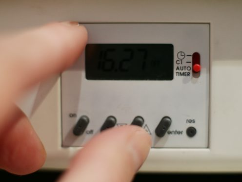 A survey found many Britons plan to ration their heating during the coming months to keep costs down (PA)