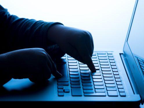 A child's hands on the keys of a laptop keyboard (Dominic Lipinski/PA)