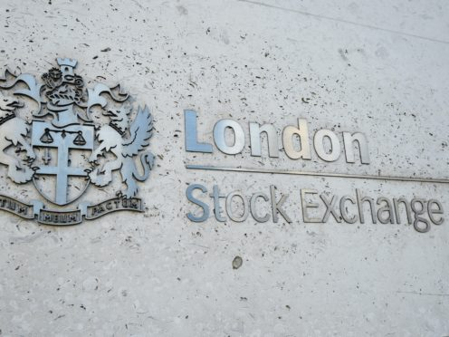 The FTSE 100 Index slid lower (Kirsty O'Connor/PA)