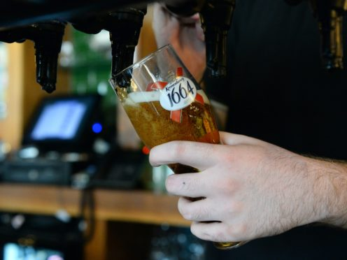 A bar tender pours a Kronenbourg beer (Kirsty O'Connor/PA)