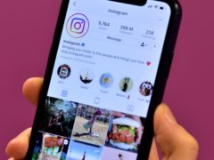 Stock photo of the home page of social media site Instagram on a smartphone.