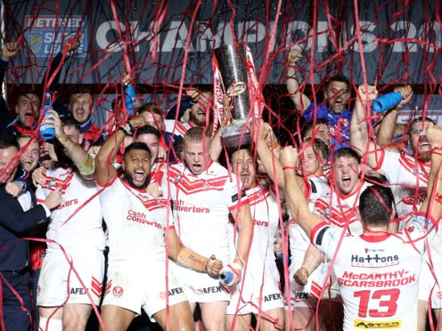 St Helens players celebrate last year's Super League Grand Final victory (Martin Rickett/PA).