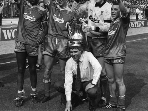 File photo dated 14-05-1988 of Wimbledon manager Bobby Gould is crowned with the FA Cup when he joined his victorious team on the turf at Wembley following their 1-0 win over Liverpool.