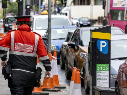 """A traffic warden patrols the streets of Belfast city centre as the lockdown suspension of on-street parking charges in Northern Ireland is set to be lifted. Wardens will issue """"warnings"""" to prepare the public for the return of charges and fines on June 29."""