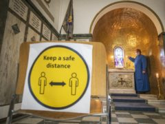 Places of worship in areas placed in either Level 2 or Level 3 would not be committing an offence if they fail to ensure people stay at least two metres apart (Jane Barlow/PA)