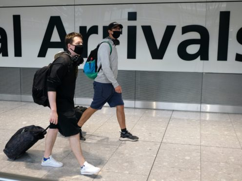 Travellers arriving in England will be able to end their quarantine with a negative coronavirus test after five days from December 15, Transport Secretary Grant Shapps has announced (Andrew Matthews/PA)