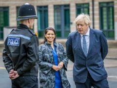 Boris Johnson said he had 'full confidence' in Home Secretary Priti Patel (Charlotte Graham/Daily Telegraph/PA)