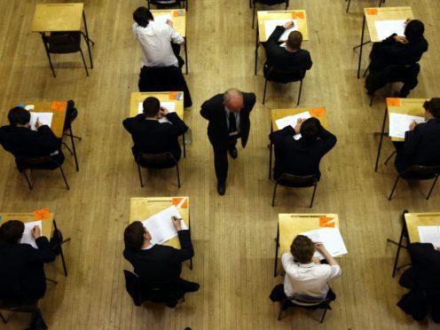 Pupils sitting an exam (David Jones/PA)