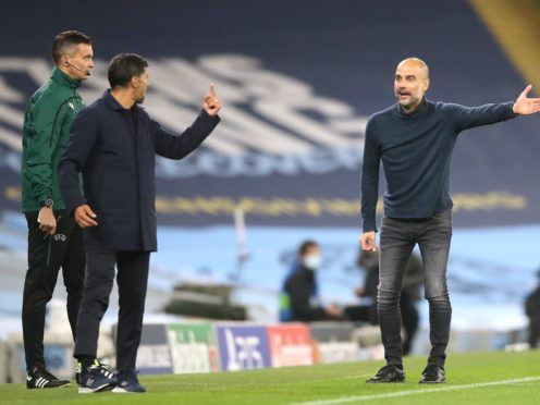 Pep Guardiola (right) and Sergio Conceicao (left) exchanged words when Manchester City faced Porto in October (Martin Rickett/PA)
