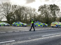 Welsh police pull over cars at a checkpoint close to the border between Carmarthenshire and Pembrokeshire (Ben Birchall/PA)