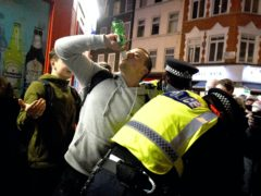 Revellers celebrate in Soho, London, while near Liverpool police were attacked at a bonfire (Kirsty O'Connor/PA)