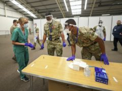 NHS staff and soldiers prepare at the Liverpool Tennis Centre in Wavertree, ahead of the start of mass Covid-19 testing in Liverpool (Peter Byrne/PA)