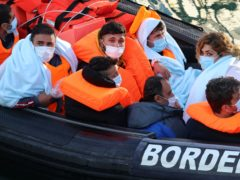 A group of people thought to be migrants are brought in to Dover, Kent, onboard a Border Force vessel following a small boat incident in the Channel (Gareth Fuller/PA)