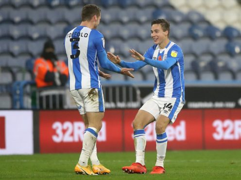 Huddersfield's Carel Eiting celebrates his goal (Martin Rickett/PA)