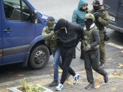 Police detain a man (AP)